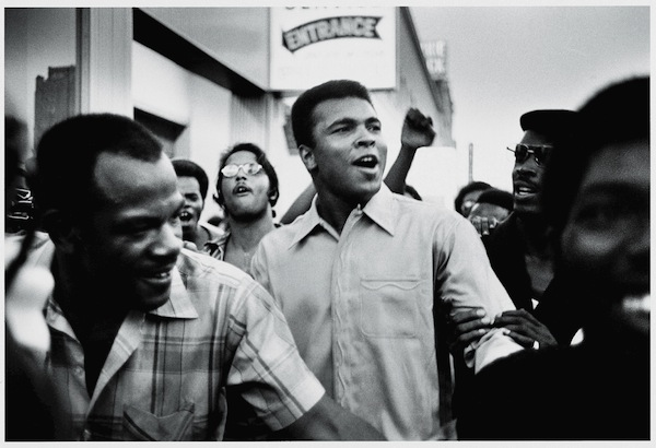 Muhammad Ali walks through the streets of New York City with members of the Black Panther Party in September 1970. Credit: David Fenton/Archive Photos/Getty Images