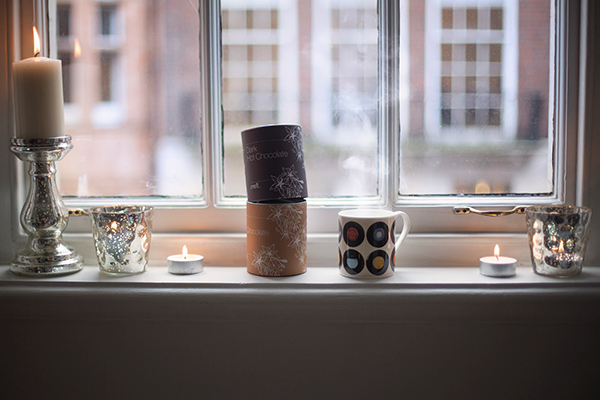 Mercury candle stick and frosted tealight holders  by The White Company, dark and milk hot chocolate by Melt, sevens taupe mug by Ella Doran