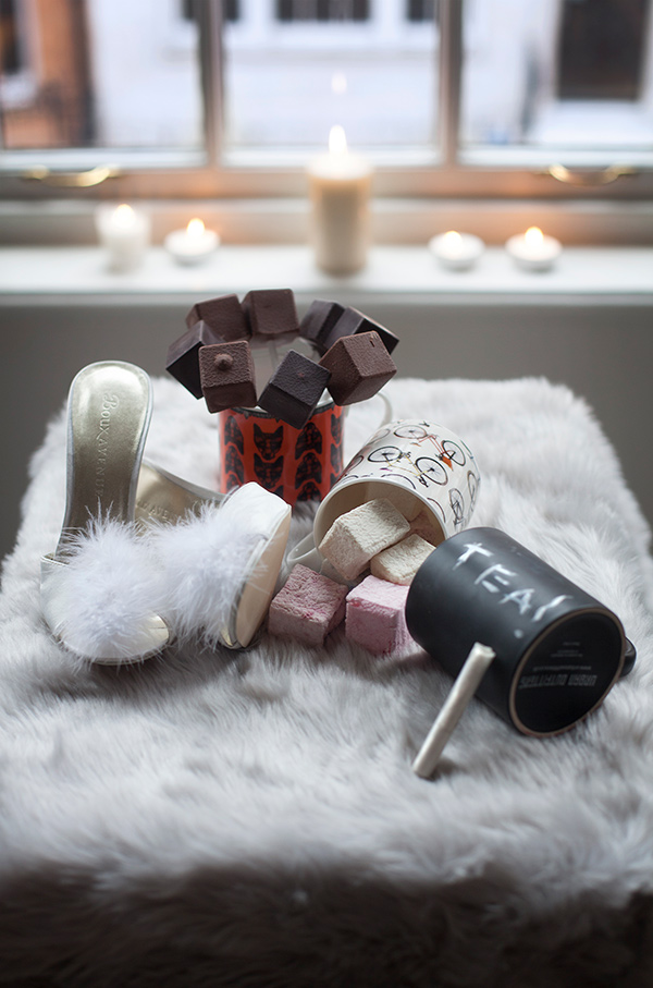 Stiletto slippers by Boux Avenue, fox mug by Lisa Bliss, mixed origin milk and dark hot chocolate sticks by Melt, bicycle mug by Ella Doran,  chalkboard mug by Urban Outfitters, marshmallow by Fortnum and Mason,  faux fur throw by The White Company