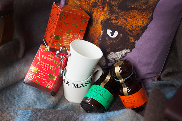 Zesty orange and midnight hot chocolate flakes by Prestat, key mug by Gary Birks, F&M mug and mint and orange hot chocolate, by Fortnum and Mason, fox cushion by Lisa Bliss, mohair throw by John Hanly & Co. Ltd.