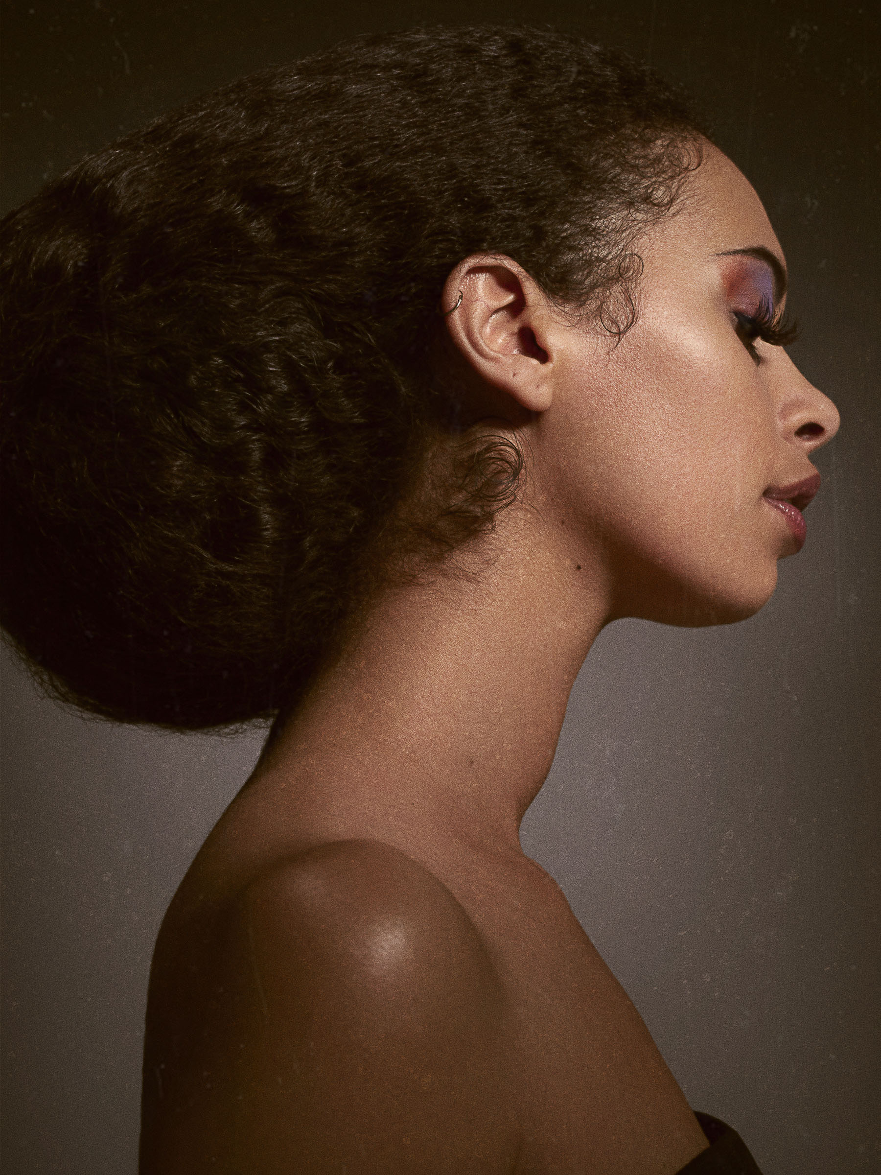 Side profile of a woman with Makeup and long lashes